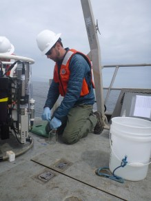 NOAA Corps Lieutenant Justin Ellis preparing to collect water samples from the Niskin bottles on the OCNMS rosette.