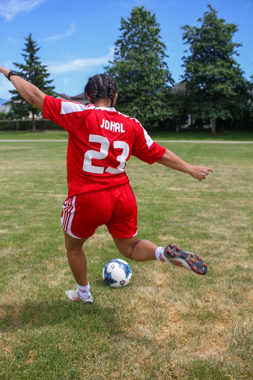 Anjali playing soccer