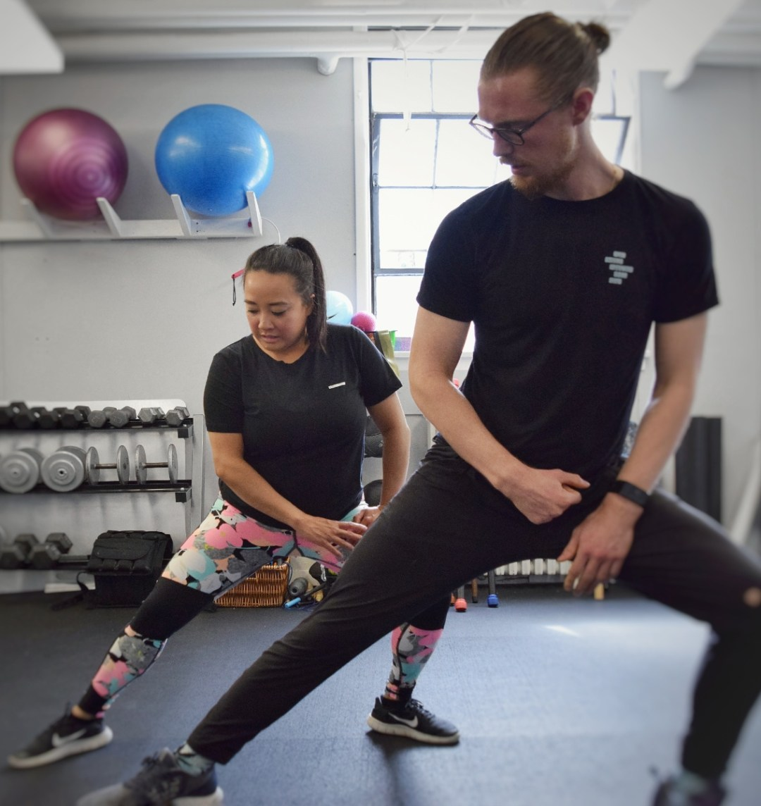 physiotherapist doing exercise with patient