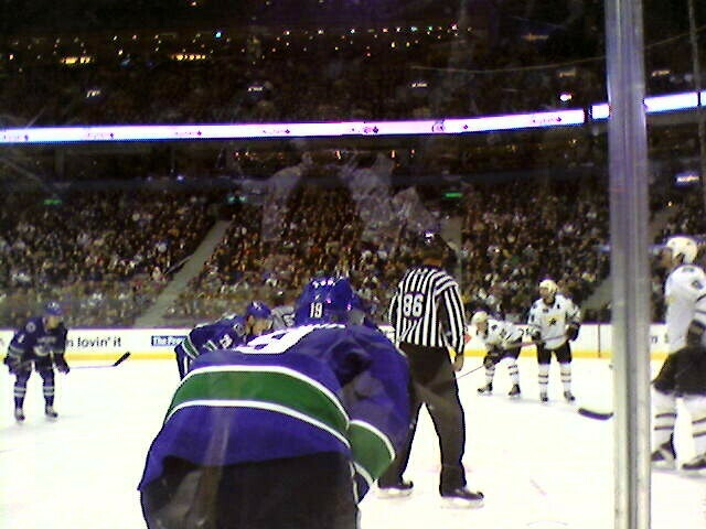 The Canucks line up for a faceoff.