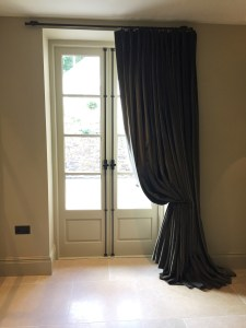 Bespoke curtain rail and curtain tie back by West Country Blacksmiths