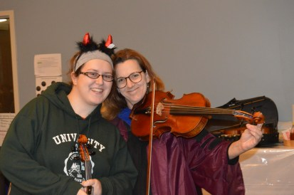 Mother-daughter violists getting tuned up!