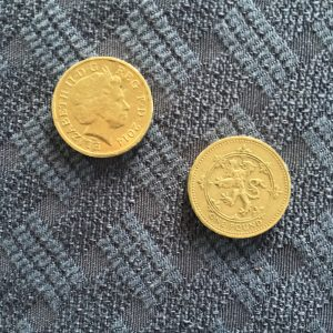 The 1 pound coin, front and back. Don't go looking for a bill.