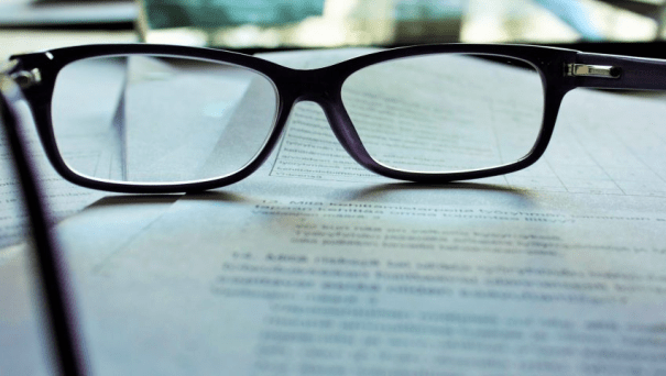 Related Image: an business person's glasses on a serious-looking document