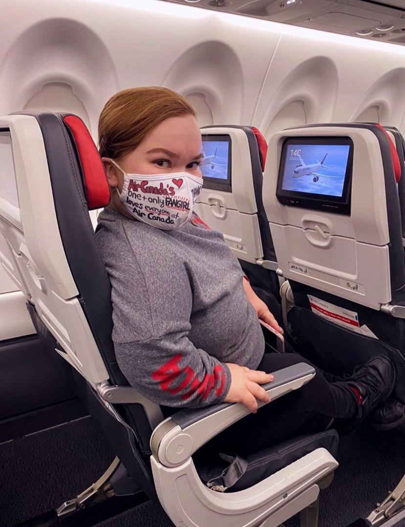Zoe Elverum in an Air Canada A220 seat.