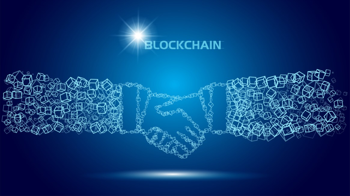Blockchain technology agreement handshake business concept.