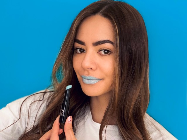 A model posing with the featured blue lipstick for Liptember