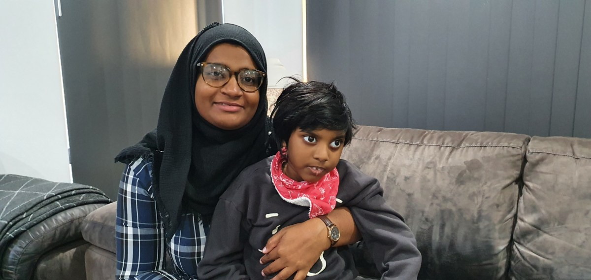 Kayban Jamshaad is held by his mother, Shizleen Aishath