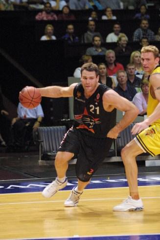 Andrew Vlahov dribbling a basketball.
