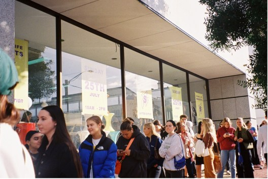 A line of customers waiting outside the building at the last event.
