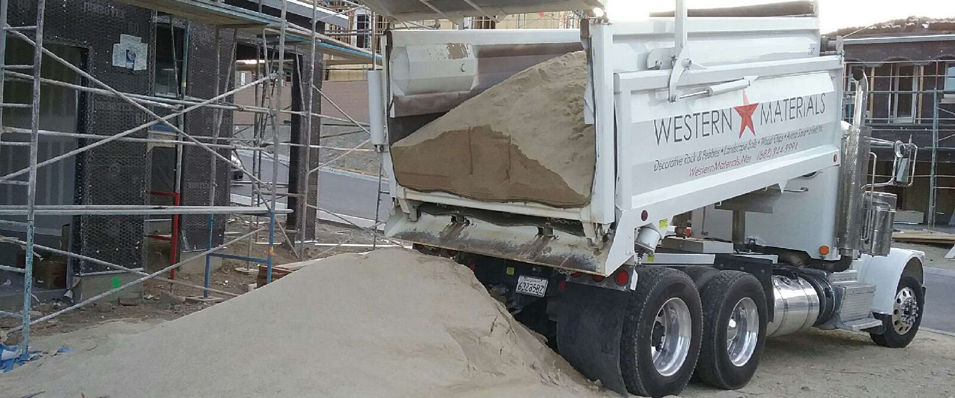 dump truck carrying sand