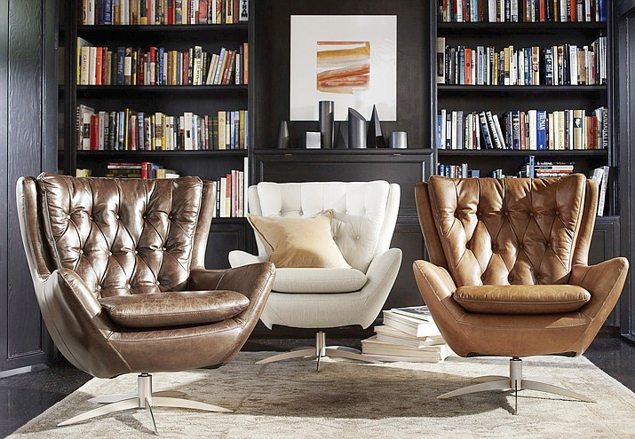 traditional wingback chair faux wood adirondack chairs wing with modern twist the daily courier this undated photo provided by pottery barn shows wells swivel