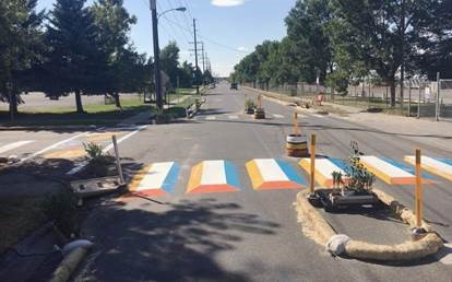 Temporary traffic calming installation in Bozeman, Montana with pedestrian crossing marked in temporary paint