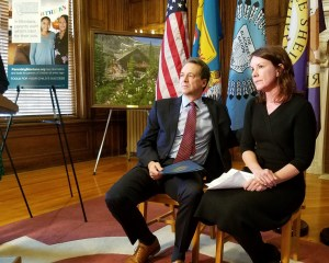 Photo of Montana Governor Steve Bullock and Annmarie McMahill seated at a news conference