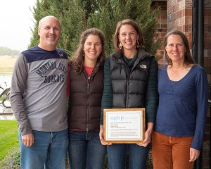 Group photo of David Kack, Danae Giannetti, Dani Hess and Rebecca Gleason with award plaque in 2019