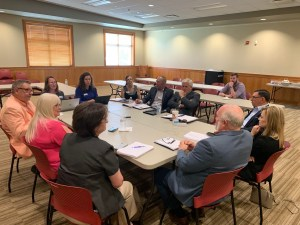 Rebecca Gleason and Danae Giannetti (far left) introduce new research project to Frontier Metropolitan Planning Organization in Fort Smith, Arkansas.