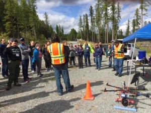 Colin Brooks and Rick Dobson of Michigan Technological University demonstrate an unmanned aerial vehicle (UAV) during a field tour at the 2019 Low Volume Roads conference.