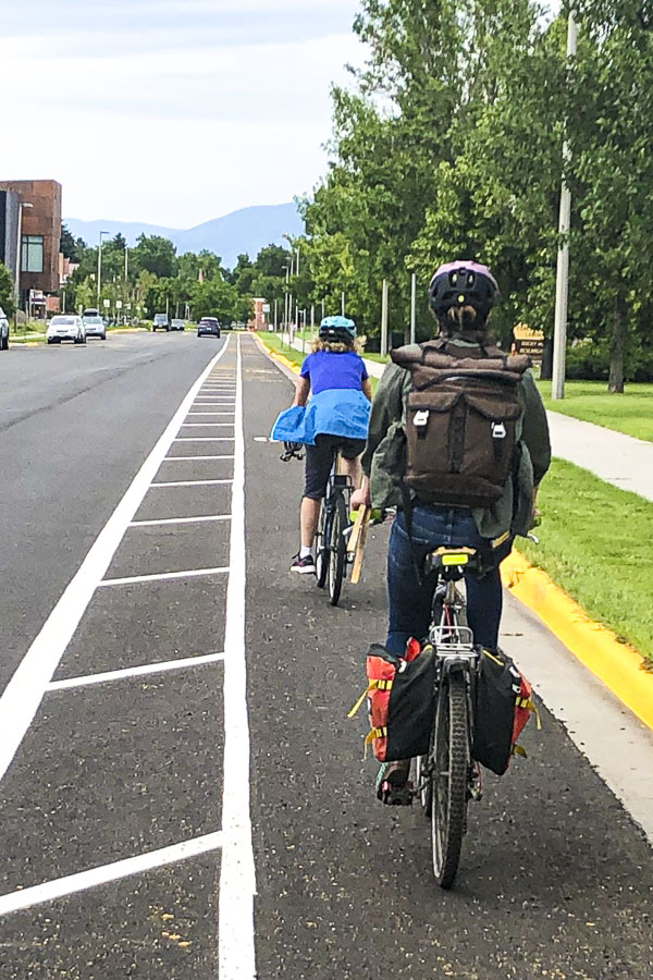 Two cyclists on designated bike lane.