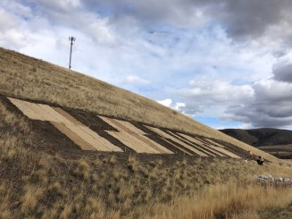 Erosion control blankets installed on hillside in Idaho 2018