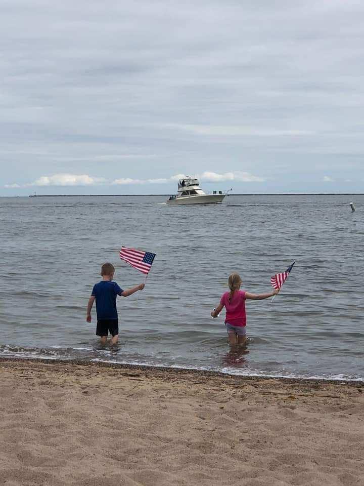 Boat parade celebrates centennial, shore