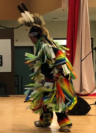 Cultural Credit member, Micheal Esquash, dancing at the Winter Solstice dinner.