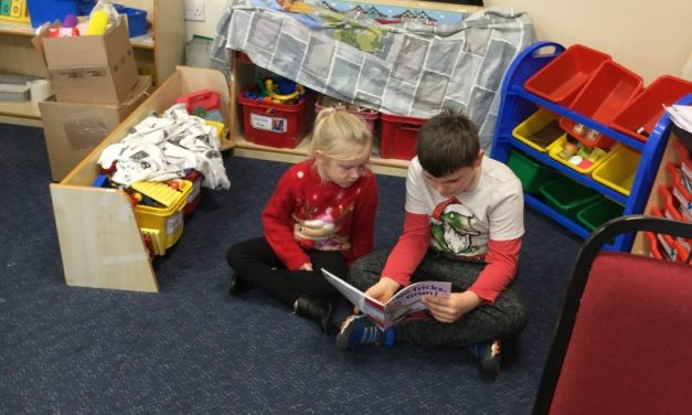 Sharing books with our Reading Buddies in Year 1