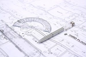 Drawing plan with pencil and protractor on it