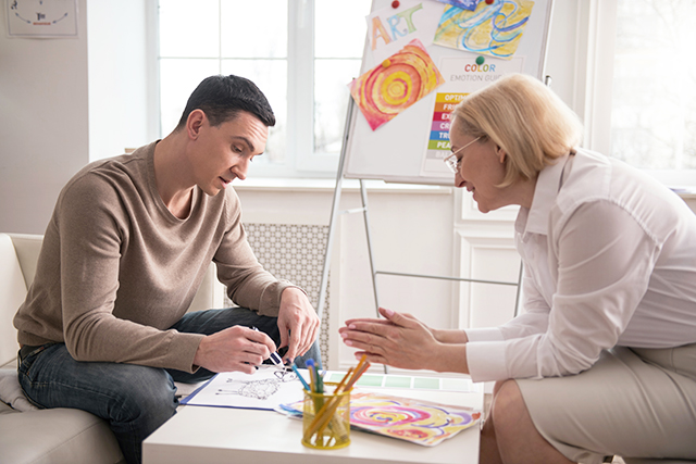 Art therapist working with young man