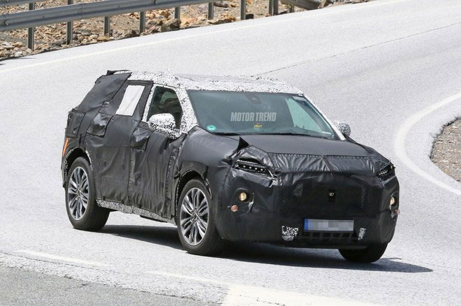 SPIED! CHEVROLET MIDSIZE SUV PEEKS OUT FROM UNDER THE CAMO
