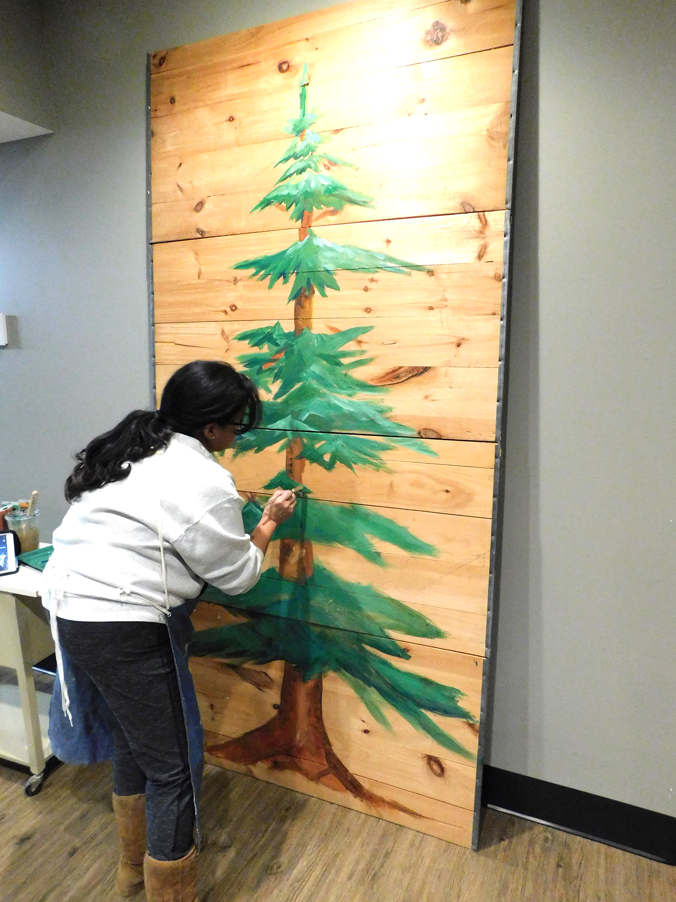 Mrs. Zeigler Painting our Christmas Tree
