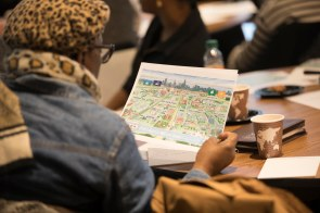 At the February 28 gathering, a West Side resident looks at the West Side United Root Map.
