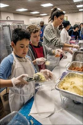 Thanksgiving volunteers servcing line