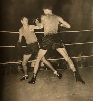 Ray Quant MBE. The Boxer. He says: 'notice the officers sat near the ring in their mess dress, whilst the boxers are like gladiators.
