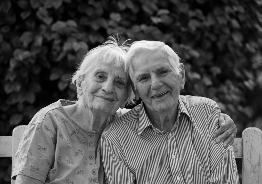 John and Adelaide Martin sit together on a bench in Tanygroes, 2018.