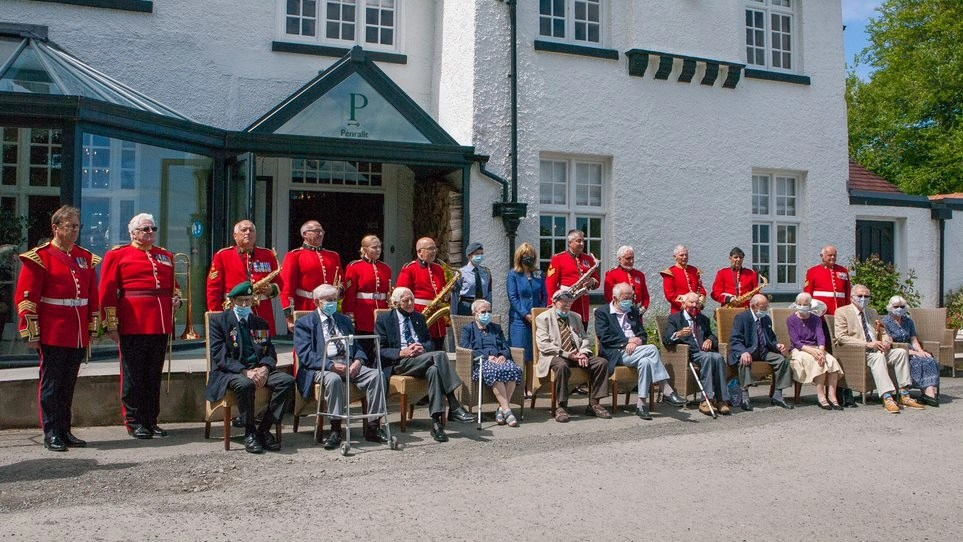 """World War Two veterans and the band of the Royal British Legion, Llanelli Branch, at """"Our Greatest Generation,"""" an Age Cymru Dyfed event commemorating the 77th anniversary of D-Day. June 6th, 2021."""