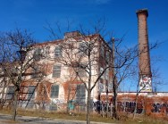 The former Canada Linseed Oil Mills (with turquoise spray-portrait by mural artist, Anser)