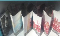 """Rochelle Rubinstein's little gallery contains her beautiful printed art book, """"Catale Huxule."""""""