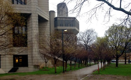 U of T's Robarts Library (and its periscope!) loom large around the little cherry tree alley