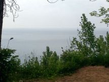 Looking south from the forest: slightly misty Lake Ontario view over the edge. The property is situated on top of the Scarborough Bluffs.