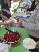 Layering the cake with strawberries and whipped cream... Proof positive that it is now, finally, summer!