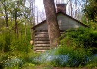 Old log cabin, on the premises before the Guild.