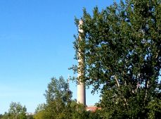 A view of two towers: the CN in the distance, and the Hearn Generating Station chimney, nearby.