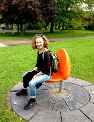 """While we waited, we discovered the """"TULPI"""" (sic!) chairs - a gift from visiting Netherlands royals, last year. The modular tulip-shapes unfold to make a seat. Kind of cute. But it looked like most of them had broken. Or just needed to be reinstalled. With a half-dozen of them, it probably looks like a delightful field of giant tulips. (With one surviving, alas, it looks a bit forlorn. Maybe they'll fix that.)"""