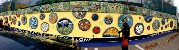 """Panorama of some of the Coxwell Laneway Mosaic Mural. The quote is from Canadian politician, Agnes Macphail: """"Equal right to all, special privileges to none. We meet all life's greatest tests alone."""""""