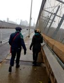 Veronika and Julie brave high winds and cool broken snow-bits as we cross the Bloor Viaduct.