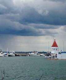 pretty marina building and skies clearly raining down on Burlington in the distance!