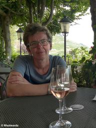 Natascha with wine glasses, in the vineyards of Lavaux
