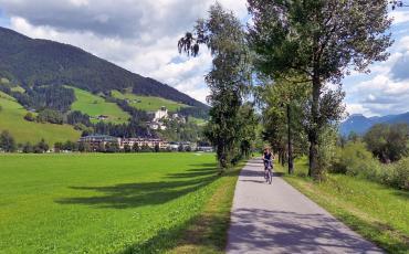 Cyclist on the river Drau cycling path