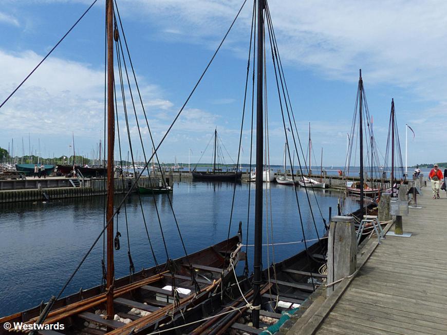 Reconstructed Viking ships at a pier