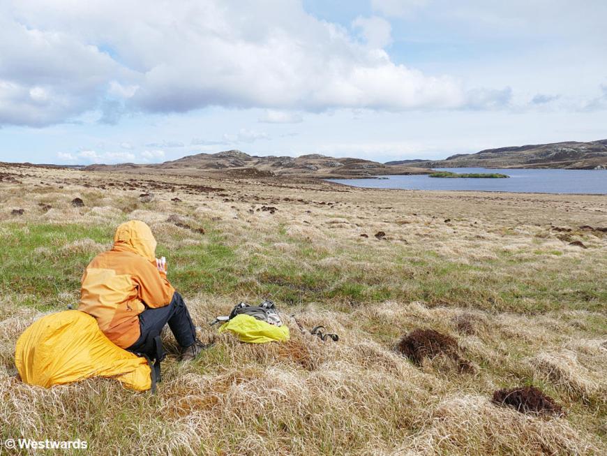 Hikerson the moor near Harris,  taking a break on the Hebridean Way